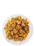 Fusilli pasta with sausage and vegetables. top view. isolated Stock Photo