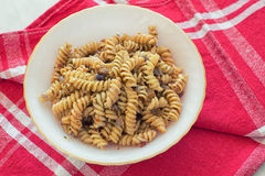 Fusilli pasta. With spice on a plate stock image