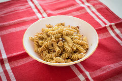Fusilli pasta. With spice on a plate royalty free stock photos