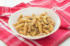 Fusilli pasta. With spice on a plate royalty free stock photo