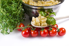 Fusilli pasta with thyme and tomatoes Royalty Free Stock Photo