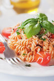 Fusilli pasta in tomato sauce Royalty Free Stock Images