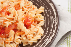 Fusilli pasta with tomato sauce Royalty Free Stock Photography