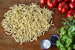 Fusilli pasta tomatoes and herbs Stock Photos