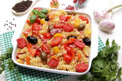 Fusilli pasta with tomatoes, olives and peppers Royalty Free Stock Image