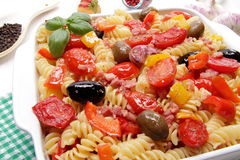 Fusilli pasta with tomatoes, olives and peppers Royalty Free Stock Photo
