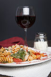 Fusilli Pasta with Tomatos and Fresh Baby Spinach Royalty Free Stock Photography