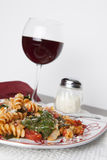 Fusilli Pasta with Tomatos and Fresh Baby Spinach Stock Images
