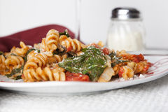 Fusilli Pasta with Tomatos and Fresh Baby Spinach Stock Photo