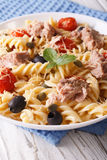 Fusilli pasta with tuna, parmesan and tomatoes in a bowl close u Stock Photo