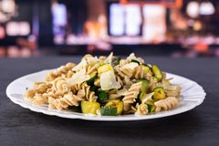 Fusilli pasta with zucchini with restaurant stock image