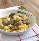 Fusilli pasto with chicken liver Stock Image
