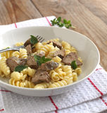Fusilli pasto with chicken liver Royalty Free Stock Photos