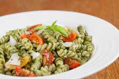 Fusilli with pesto, cherry tomatoes and parmesan Stock Image