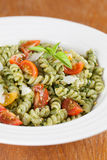 Fusilli with pesto, cherry tomatoes and parmesan Royalty Free Stock Photo
