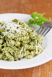 Fusilli with pesto and parmesan Stock Images