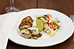 Fusilli salad served with chicken roulade Stock Images