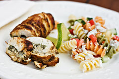 Fusilli salad served with chicken roulade Stock Photo