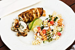 Fusilli salad served with chicken roulade Stock Photos