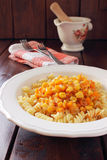 Fusilli with sauce made ��from corn, carrots Royalty Free Stock Photo
