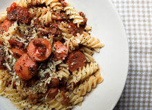 Fusilli with sausage and parmesan Stock Photo