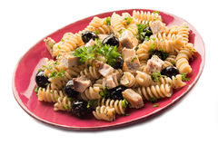 Fusilli with swordfish and black Royalty Free Stock Photos