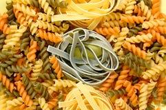 Fusilli and tagliatelle pasta Stock Photos