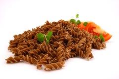 Fusilli twirls pasta. Italian food background Stock Images