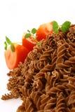 Fusilli twirls pasta. Italian food background Stock Image
