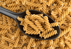 Fusilli whole wheat organic pasta on a spoon Stock Photos