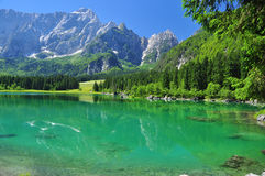 Crystal clear Fusine lake, Alpine scenery. Friuli, Italy Stock Photo