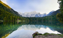 Fusine lakes. Italy. The picturesque landscape of the mountains of Dolomites, pine trees and lake Fusine, Italy Royalty Free Stock Images