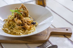 Fusion aglio olio spaghetti with fried soft shell crab Stock Photos