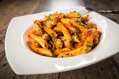Fusion cuisine - italian pasta and greek beans Royalty Free Stock Photography