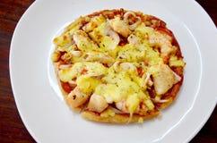 Fusion cuisine between muslim food and italian food. Roti pizza seafood hawaiian recipe stock photos