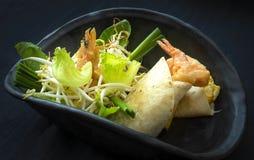 Fusion food. On black dish stock photo