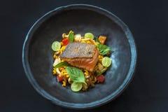 Fusion food. On black dish stock photography