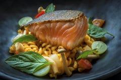 Fusion food. On black dish stock photos