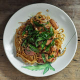 Fusion food, Chili chinese noodle and bacon mixs hot basil.  royalty free stock images