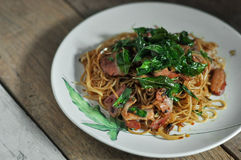 Fusion food, Chili chinese noodle and bacon mixs hot basil.  stock images