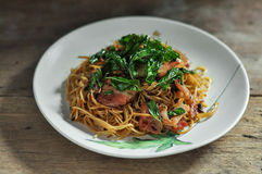 Fusion food, Chili chinese noodle and bacon mixs hot basil.  stock photo