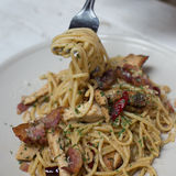Fusion food - Spicy spaghetti with bacon and basil.  stock image