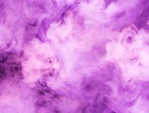 Fusion of purple smoke in motion. On black background stock images