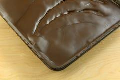 Fuskverknissen med chokladisläggning Arkivbild