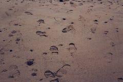 Fuss-Drucke im Sand Lizenzfreie Stockfotos