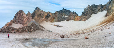 Fuss Peak Volcano, Paramushir Island, Russia. Trekker at crater of Fuss Peak Volcano, Paramushir Island, Kuril Islands, Russia Stock Photo