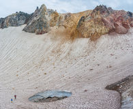 Fuss Peak Volcano, Paramushir Island, Russia. Trekker at crater of Fuss Peak Volcano, Paramushir Island, Kuril Islands, Russia Royalty Free Stock Photography