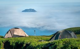 Fuss PeTourist tents in the  mountains, Paramushir. Tourist tents in the  mountains, Paramushir Island, Kuril Islands, Russia Stock Photography