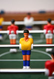 Fussball Player. Player on the yellow team of a fussball (fozzball) table game Royalty Free Stock Photography