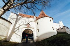 FUSSEN, GERMANY - DECEMBER 2018: woman standing at the entrance of Hohes castle.  royalty free stock images